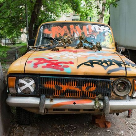 Russian street artists delete car in real world using clever optical illusion.