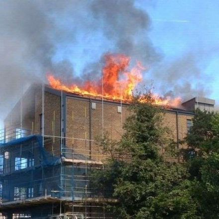 Blaze rips through roof of million-pound London flats as picture shows solar panels on fire