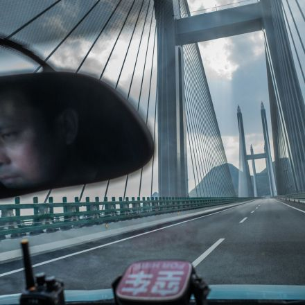 China's New Bridges: Rising High, but Buried in Debt