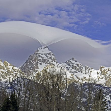 Mysterious, Wavelike Cloud Hugs Grand Teton Mountains