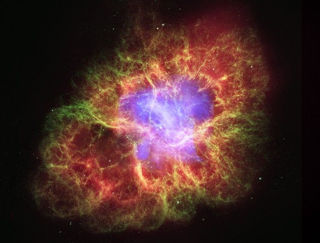 Crab Nebula (2006) - False color image using data from Chandra, Hubble and Spitzer. Blue-purple=x-rays, green=optical, red=infrared.