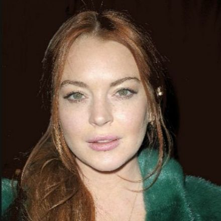 Lindsay Lohan Gets Punched in Face After Accusing Refugee Family of 'Trafficking' (Video)