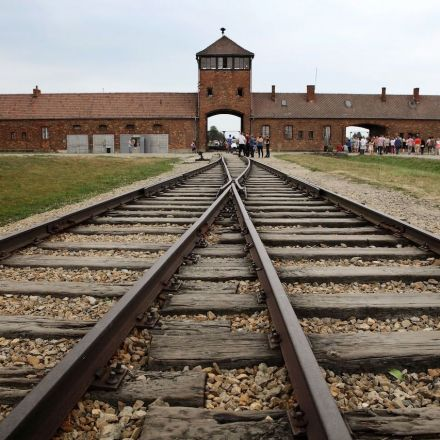 Auschwitz Memorial asks visitors to stop posing for photos on rail lines