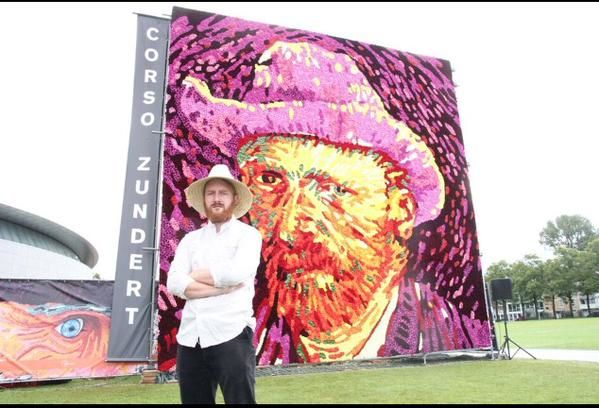 A Vincent van Gogh impersonator poses in front of the newly created work.