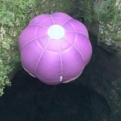 Hot air balloon descends into cave
