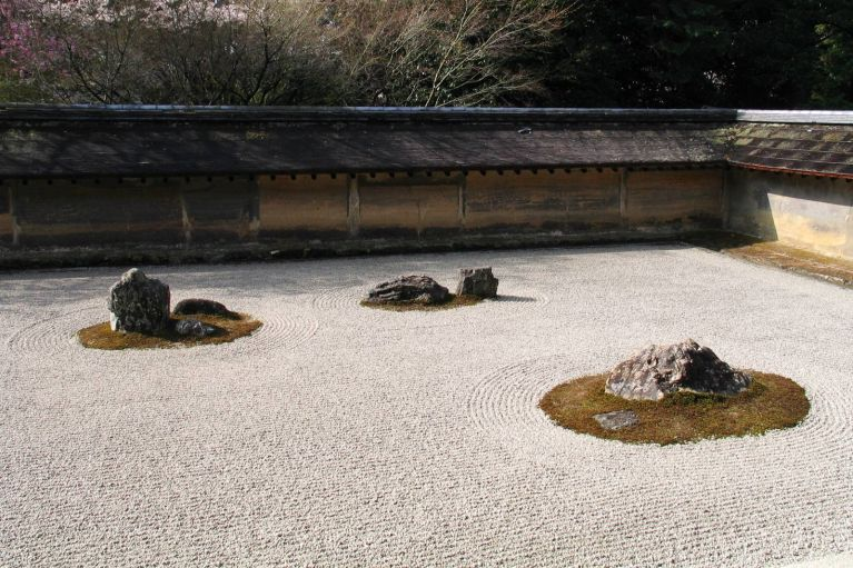 "Built during the Higashiyama period, the clay wall, which is stained by age with subtle brown and orange tones, reflects ""wabi"" and the rock garden ""sabi""."